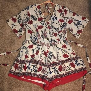 LAST CALL Floral Romper with tied waist